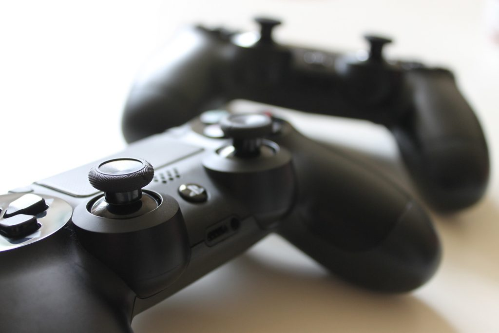 A photo of two PS4 controllers